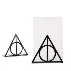 A set of bookends that look like the symbol of the Deathly Hallows.