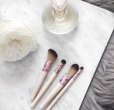I love the different textures and patterns from the contract of the marble palette to the fur in this flatlay. I like how it's such a simple and chic layout.