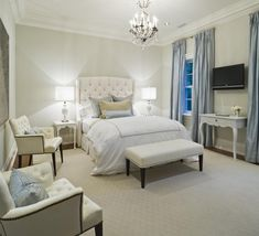 Taylor Hannah Architect: Modern French bedroom design with light gray walls paint color and glossy white bedroom ...