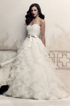 This is my favorite, minus the bow.  Style #4363 from Paloma Blanca. Sweetheart lace bodice with ribbon and brooch at waist. Ruffled organdy skirt.