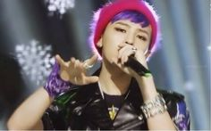 ONLY G-DRAGON can put on a fluffy pink beanie with his purple locks, and pull it off and make it look REALLY GOOD.