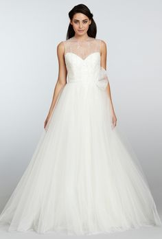 DESIGNER: Tara Keely by Lazaro STYLE: 2302 NECKLINE: Sweetheart with Beaded Illusion Tulle Bodice SILHOUETTE: A-line FABRIC: Mikado / Organza / Tulle COLOR: Ivory FEATURES: Keyhole back, beaded horsehair belt TRAIN: Chapel CONDITION: Sample from boutique, no rips, tears, snags or stains SIZE: 12 PRICE: $1,880.00