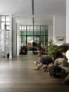 Lobby at the Crosby Street Hotel in New York. Love the weathered animals at right.