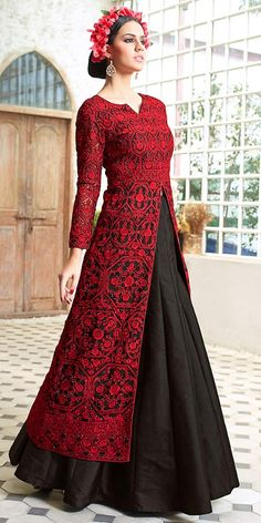 Enticing Red Silk Lehenga Choli With Dupatta.
