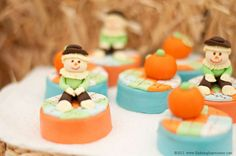 Cute fondant scarecrows on chocolate Oreos at a Thanksgiving  party!  See more party planning ideas at CatchMyParty.com!