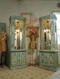 Love these vintage curio cabinet's with the chandeliers built in