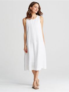 White a line dress linen summer.  Center seam front and back.  Good for a top, too, not too bell-like at hem though.  avoid maternity look