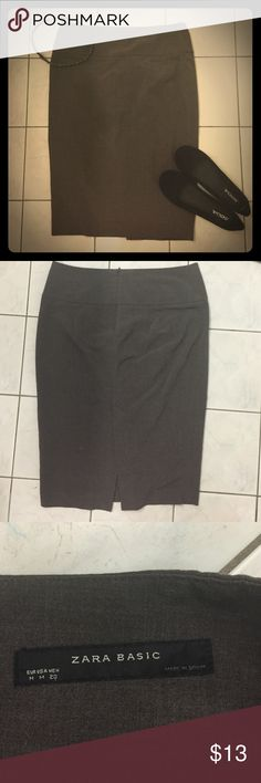 Gray-Brown Knee Length Zara Skirt This Zara skirt is the perfect addition to your wardrobe. The material is soft, and it is flattering and professional. It has a back zipper and a slit in the back. This is a really nice skirt, make it yours for a fraction of the original price! Zara Skirts Midi