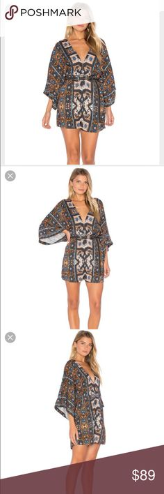"CLEOBELLA PARIS ROMPER FROM REVOLE BACK KEYHOLE BACK FEATURE. SIDE POCKETS. RAYON BLEND. ALL OVER BOHEMIAN PRINT. STUNNING UNIQUE ROMPER. MEASUREMENT. 30"" LENGTH. SLEEVES 20"". LEG OPENING 26"". NO TRADES.  NO LOWBALLS. THANK YOU FOR STOPPING BY. PLEASE DON'T HESITATE TO ASK QUESTIONS. Cleobella Pants Jumpsuits & Rompers"