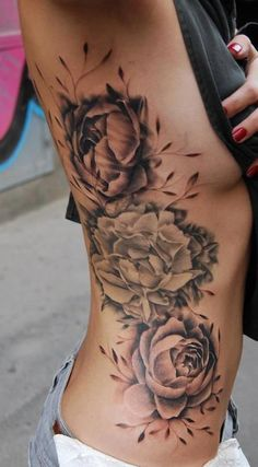 "Black and white peony rib tattoo. ""Rose without thorns""."