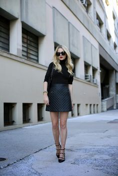 Black turtle neck + black quilted skirt