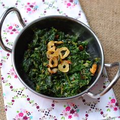 Sauteed spinach with garlic cloves and curry powder.