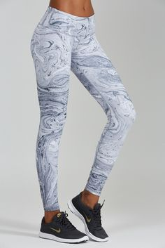 NEW for Summer! Marble Print leggings are white hot. Sophisticated, stylish and sexy this print will turn heads. A wide flattering waistband will slim and tuck. Each piece is unique in the all over pr