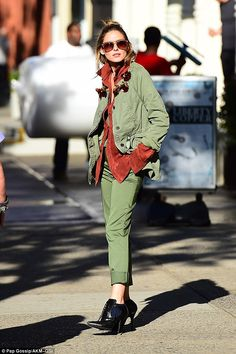 A natural: She wore a green top underneath a maroon suede shirt. Over the top of that she ...