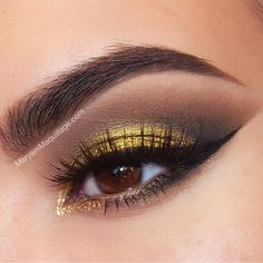 Eye makeup on brown eyes. Gold liquid pigment with chocolate brown on crease and golden / black eyeliner. Instagram: @Maryam Maquillage