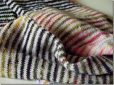 striped leftovers scarf. Just do two unifying rows of white and let it rip!!!!!