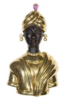 I just discovered this Blackamoor gemstone and 18k yellow gold clip brooch on LiveAuctioneers and wanted to share it with you: www.liveauctioneers.com/item/39072675