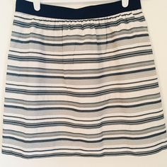 """Textured Striped skirt The shell of this skirt is 60% cotton and 40% silk, giving it an interesting texture. It is fully lined and dry clean only. It zips up the back and as an elastic band waist. Length 18.5"""" LOFT Skirts A-Line or Full"""