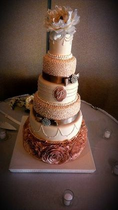 - *6 tier wedding cake all sugar work except flower on top and ribbon and brooch around cake