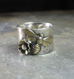 Customized bee ring made for a customer earlier this month.  The little daisy was fun to make, and so cute with the bee.  One of my favorites lately!