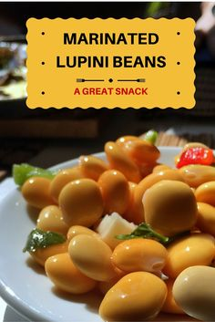 Enjoy a little Portuguese snack at home with this super easy recipe for marinated lupini beans. So yummy! #glutenfree #beans