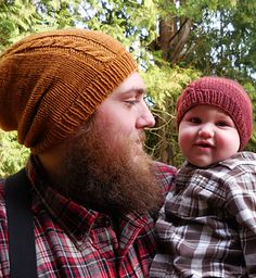 The Timber Trail Hat is a slouchy hat with an off center simple cable. It is offered in Baby Bear (Child) size, Mama Bear (Adult medium) size and Papa Bear (Adult large) size. It is modeled by myself and my two handsome guys. Enjoy!