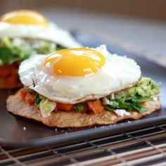 guacamole tostadas with sweet potatoes and fried eggs from the sweets life