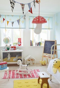 no link...but love the light, bright look of this room. and the toadstool hanging from the ceiling.