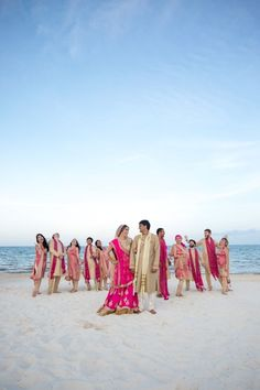 Bridal Party on the Beach   Fusion Indian Wedding   Bridal Party Attire: @Poshaac   Adrienne Fletcher Photography @adrinfletcher   Venue: Moon Palace Golf & Spa Resort in Cancun, Mexico @prweddings
