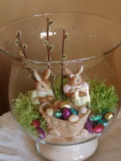 Create an Easter vignette inside a large glass vase