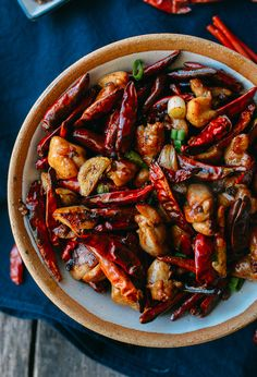 Chongqing chicken is a traditional, spicy dish of chicken and dried red chilies. Check out our authentic (albeit less oily) recipe and make it at home!