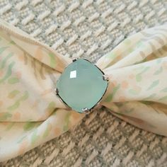 Genuine Chalcedony and Sterling Silver Ring I am selling an exquisite, genuine Chalcedony ring set in Sterling Silver.  The blue, green stone is a cushion, checkerboard cut.  All the facetes of this stone pick up light beautifully.  A true showstopper in both it's size and quality.  Handmade and stamped by a Native American artist, One-of-a-kind, like you!!  (This can easily be sized by your trusted, local jeweler.)  *****Posh Stash-Away Eligible***** Handmade Jewelry Rings