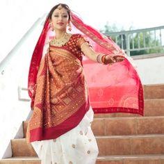 Gujarati style sari---love the white and red combo.