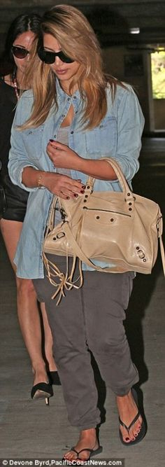 Kim Kardashian wearing Havaianas Top Flip Flops In Black Balenciaga City Bag in Sahara J.Crew Keeper Chambray Shirt Los Angeles September 19 2013