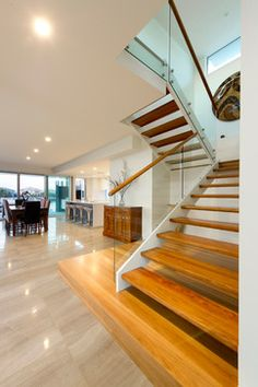 Open timber stairs.  White timber stringer.