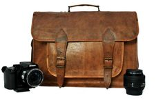 A pure leather camera bag which not only have the capacity to hold your camera but even holds all your other camera accessories like lens, charger, straps etc.