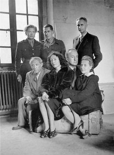 L to R - Standing - Lee Miller, Roland Penrose and Louis Aragon. Sitting - Pablo Picasso, Nusch Eluard. Paul Eluard, and Elsa Triolet. Picasso's Studio Rue des Grands Augustins Paris, 1944