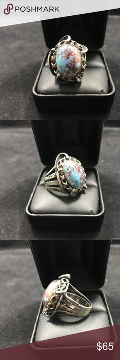 Large turquoise and silver reworked ring Stunning stone and sterling silver. It's hard to get on camera, but the colors are an exquisite blue and purplish brown. Very cool! Jewelry Rings