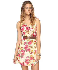 Ruffled floral dress love the color and floral print on this dress.