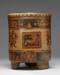 Anonymous (Mayan)  TitleTripod Vessel  DateAD 550-850 (Late Classic)  Mediumearthenware, slip paint  DimensionsHeight: 24.7 cm (9.7 in). Diameter: 20.4 cm (8 in).