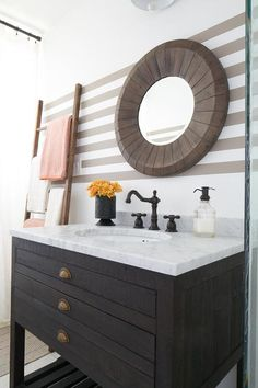A beige striped bathroom wall