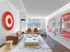 Rottet Studio Hits the Bull's Eye With Target's PR and Marketing Office. In reception, Rodolfo Dordoni's sofa is paired with a table in glass and limestone.