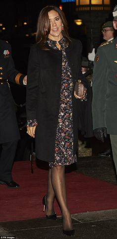 Crown Princess Mary looked stylish in a floral dress as she attended a new year concert atCopenhagen City Hall