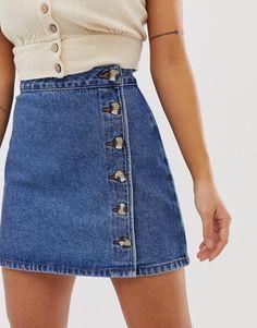 DESIGN Petite denim wrap skirt with buttons in midwash blue ASOS DESIGN – Petite jupe portefeuille en denim avec boutons bleu moyen Petite Outfits, Mode Outfits, Fall Outfits, Fashion Outfits, Denim Fashion, Fashion Goth, Steampunk Fashion, Modest Fashion, Fashion Women