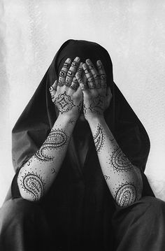 By Shirin Neshat .. She first takes photographs and then writes or draws on them .