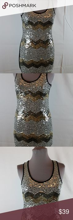 "Romeo & Juliet Couture Sequin Dress M Sleeveless Romeo & Juliet Couture (for Gossip Girl) Sequin Bodycon Dress Front is full sequin and back is solid black, quite a bit of stretch 98% cotton, 2% Spandex - Dry clean Size M Measurements are from the front laid flat (unstretched) Bust (underarm to underarm) 15"" Waist 14"" Length (shoulder to hem) 33"" Romeo & Juliet Couture Dresses Mini"