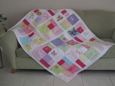 I love this quilt and the fact that it is made from repurposed baby clothes (save the memories)