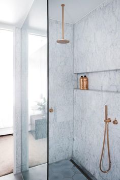 curbless shower with linear drain // i like the execution more than the actual chosen material