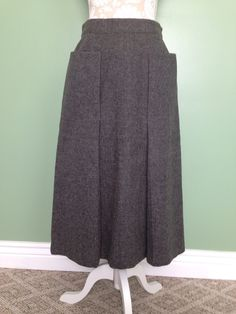 1950's grey wool A-line skirt with kick pleat and oversized pockets.  #1950s #vintage #skirts #wardrobebasics