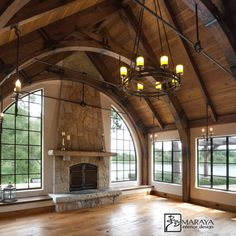Maraya Interiors walnut planked floors, real cut stone fireplace, arched wood trusses and wrought iron hardware. Old Cottage, Cottage Homes, Cottage In The Woods, Wood Truss, Natural Stone Fireplaces, Fairytale Cottage, Log Homes, My Dream Home, Future House